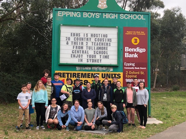 Tullamore students standing infront of EBHS sign